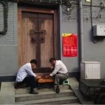 These men meet to play Chinese chess. Notice their innovative chair and table set up. They walk and set up with direction. It is likely that this game is a daily routine.